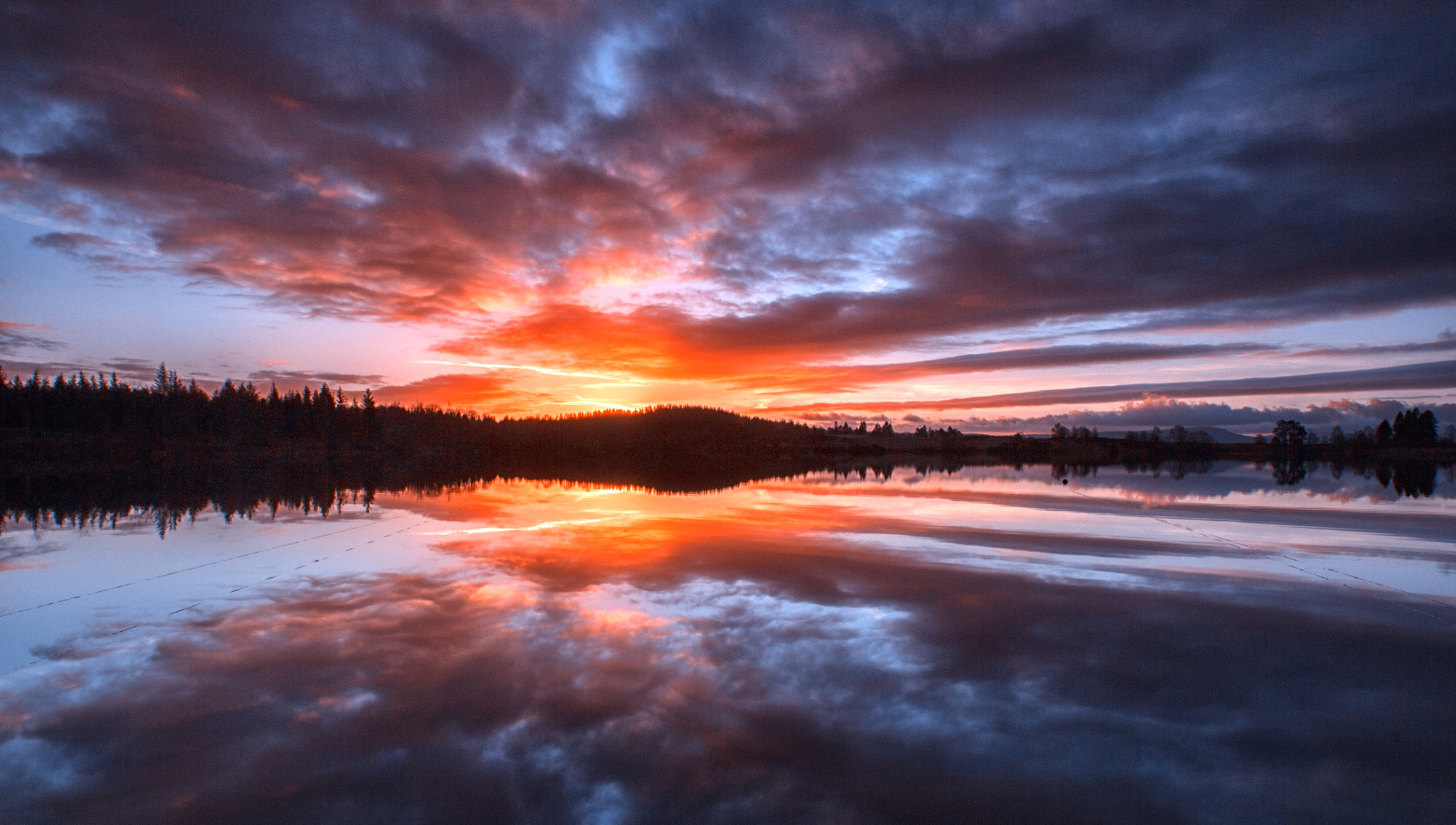 A dazzling dawn over Loch Rusky, Image by John McSporran Creative Commons