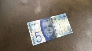A wet Bank of Scotland £5 note