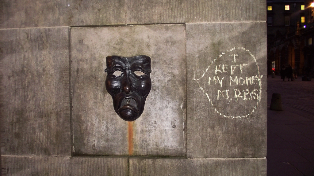 The sad face of the drama mask – with graffiti 'I put my money in RBS'