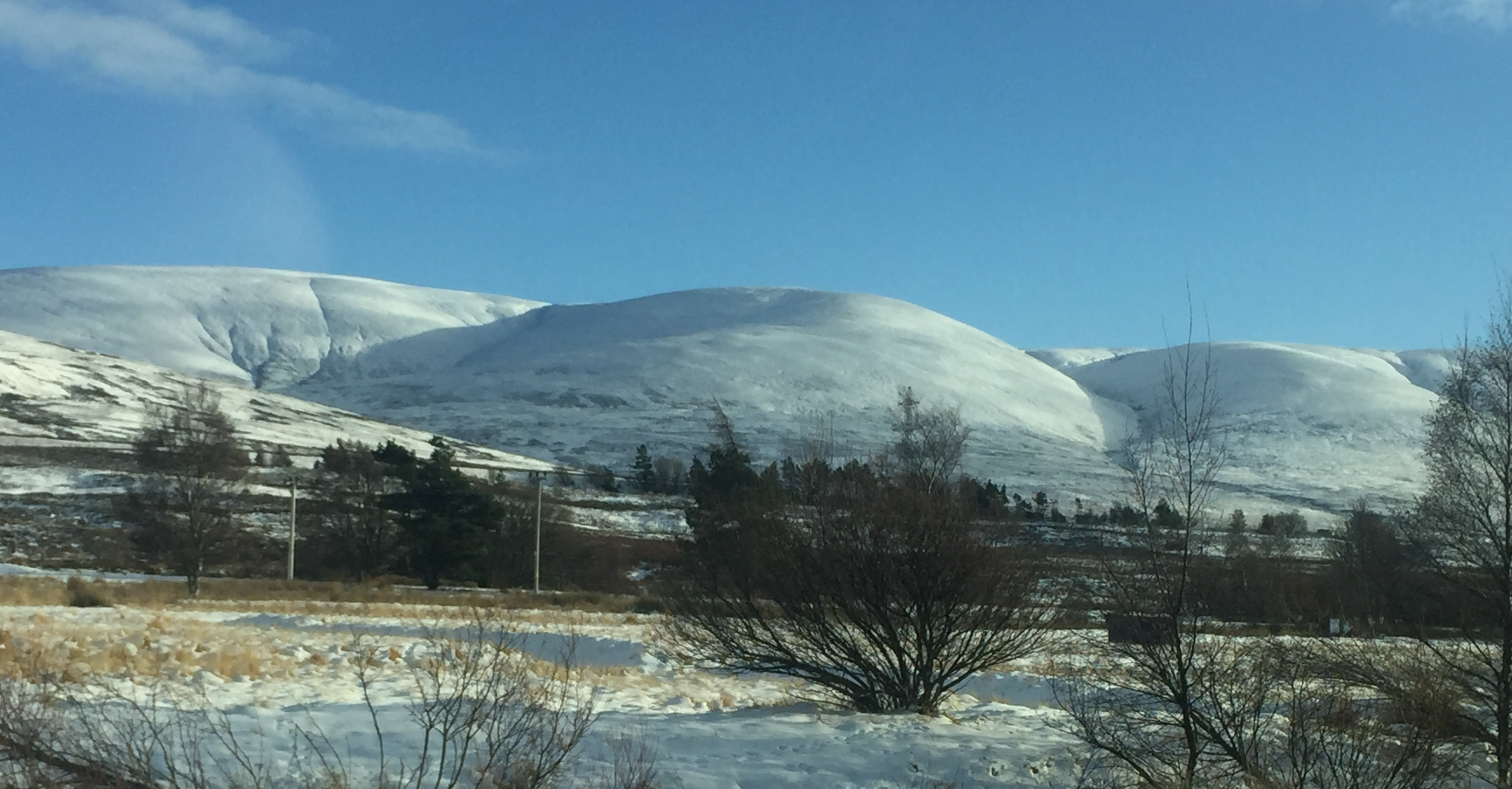 Deceptively soft, seen from a distance, the rounded snow-clad summits of Dalwhinnie Munros: photo Fay Young