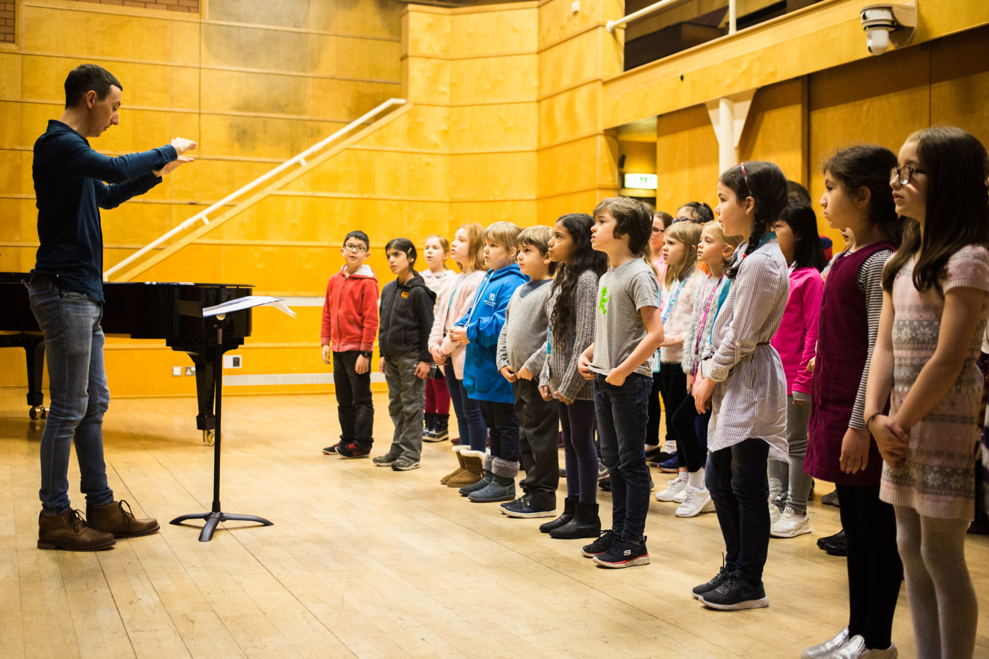 Children singing, eyes firmly fixed on the conductor. Photo Robert McFadzean, courtesy Royal Conservatoire Scotland