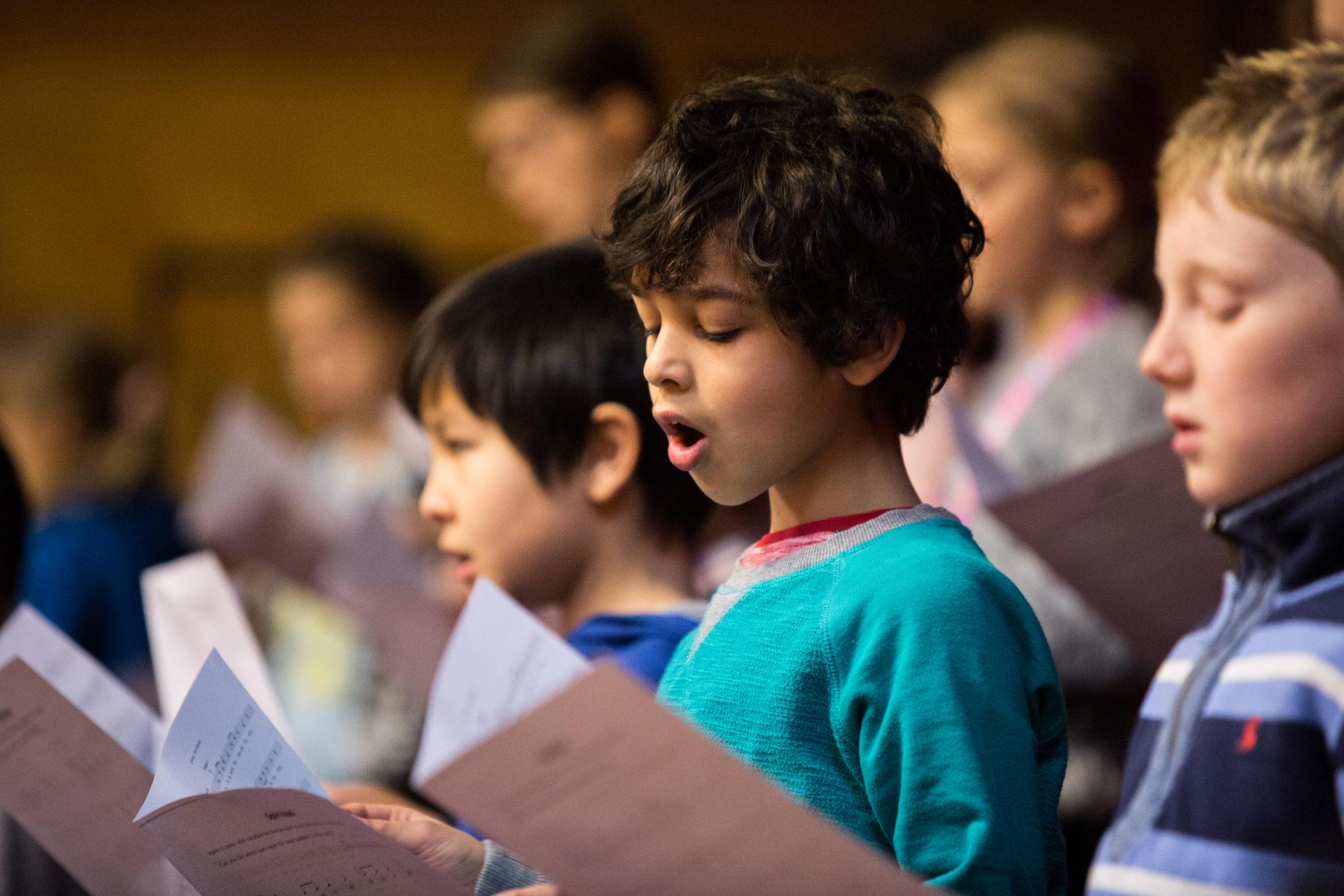 Children singing from song sheets; image Royal Conservatoire of Scotland, photographer Robert McFadzean